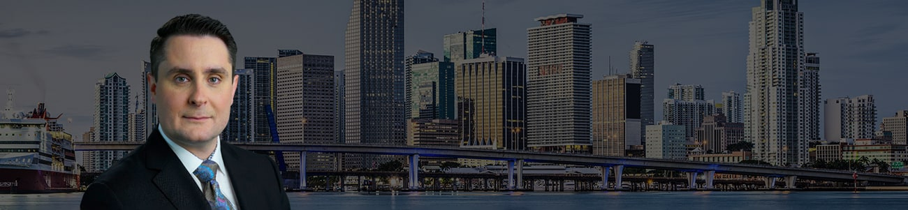 Hero Banner - profile picture of Jonathan Perazzo, Esq. over a miami skyline